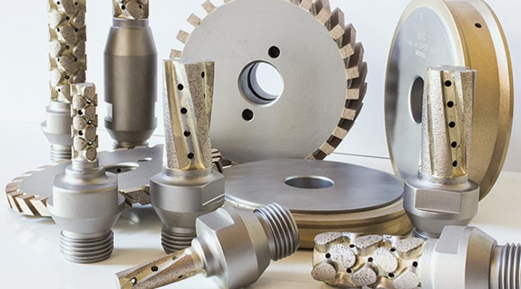 Peripheral wheels for cnc machines and for straight line edging machines